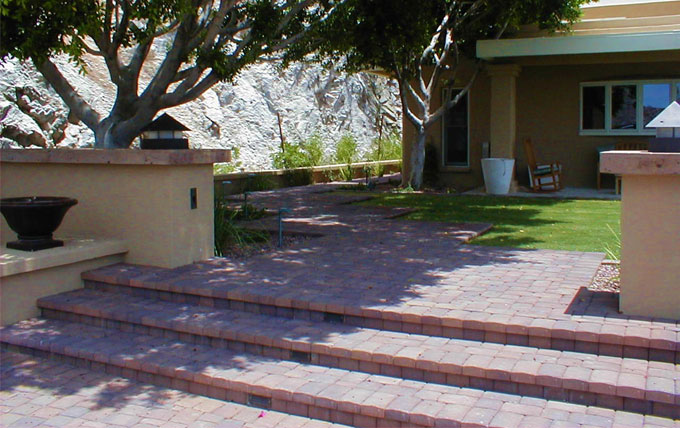 eric gilliland design – front courtyard with cantera stone capped walls and paver steps