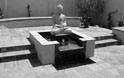 water feature with buddha and saltillo tile
